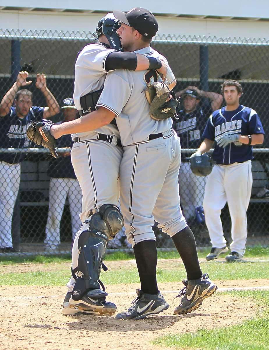 Sachem North pitcher Mike Vitale gets a hug