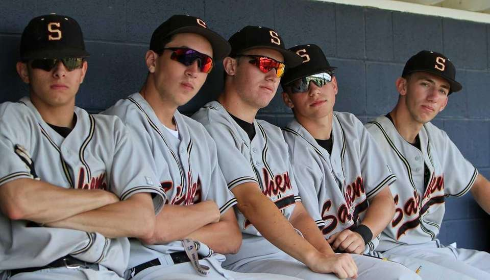 Sachem North players watch from the dugout during