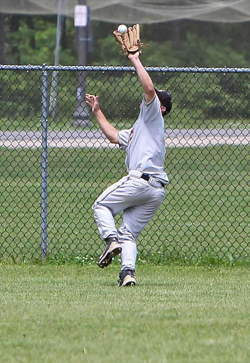 Sachem North right fielder Steve Kowalski makes a
