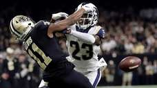 The Rams' Nickell Robey-Coleman breaks up a pass