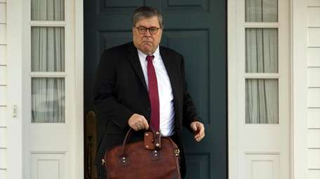 Attorney General William Barr leaves his home in