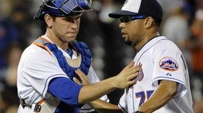 New York Mets catcher Josh Thole, left, celebrates