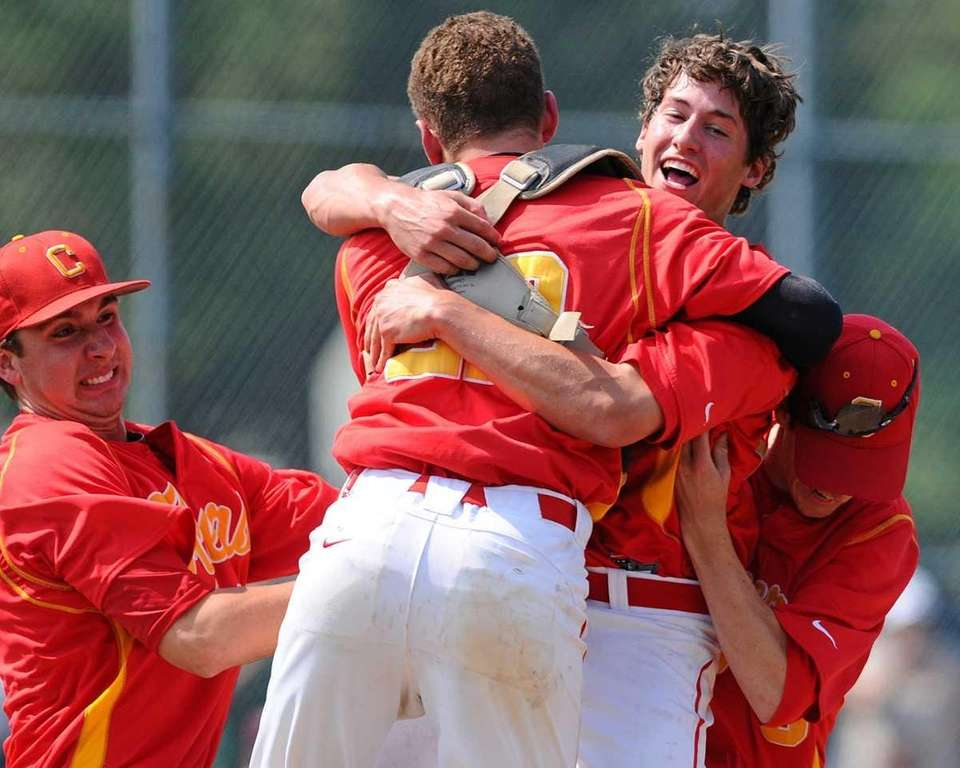 Chaminade relief pitcher Andrew Gallagher gets mobbed by
