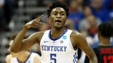 Immanuel Quickley of the Kentucky Wildcats celebrates against