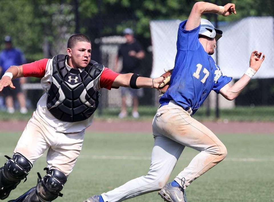 Island Trees catcher Dominick Raucci tags out Division's