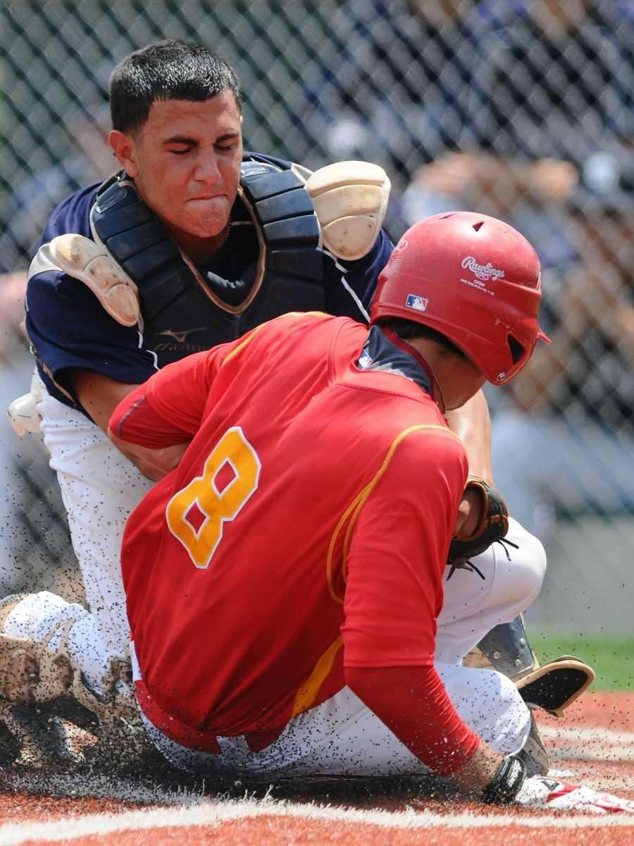 St. Dominic catcher Lou Lambros tags out Chaminade's