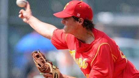 Chaminade's Andrew Gallagher throws a fastball in the