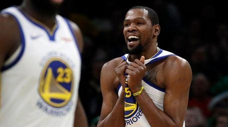 Warriors forward Kevin Durant celebrates against the Celtics