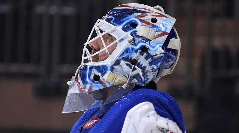 Rangers goaltender Henrik Lundqvist looks on after Detroit