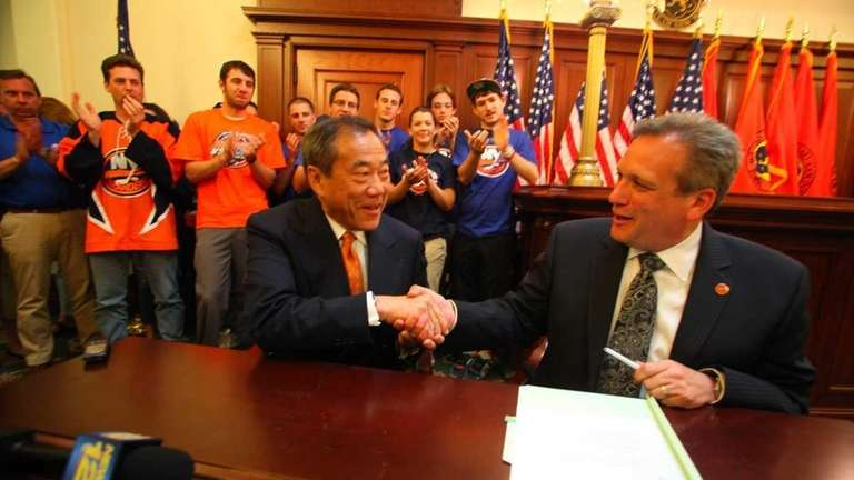 New York Islanders owner Charles Wang with Nassau
