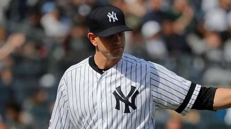 Yankees starting pitcher James Paxton motions to teammates