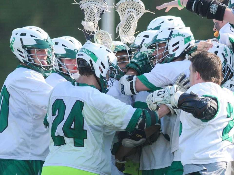 Farmingdale High School varsity boys lacrosse teammates celebrate