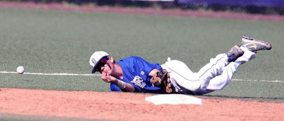 Division's Lenny Martinez can't come up with grounder.