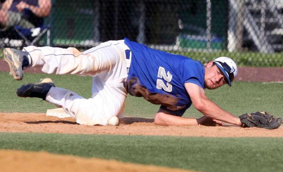 Division's first baseman Thomas Wiebke knocks down and