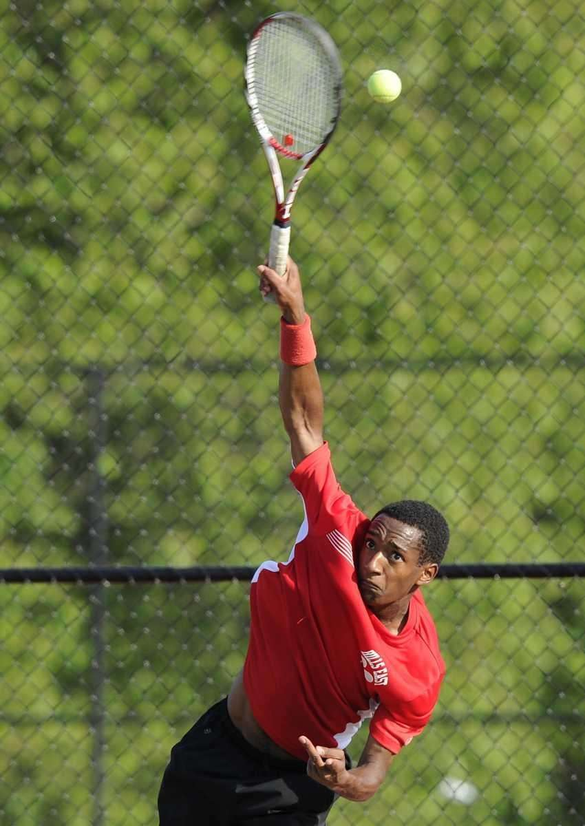 Half Hollow Hills East's Chris Hunter serves in