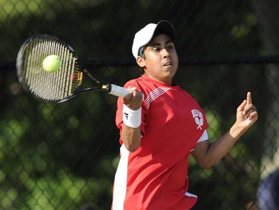Half Hollow Hills East's Zain Ali competes against