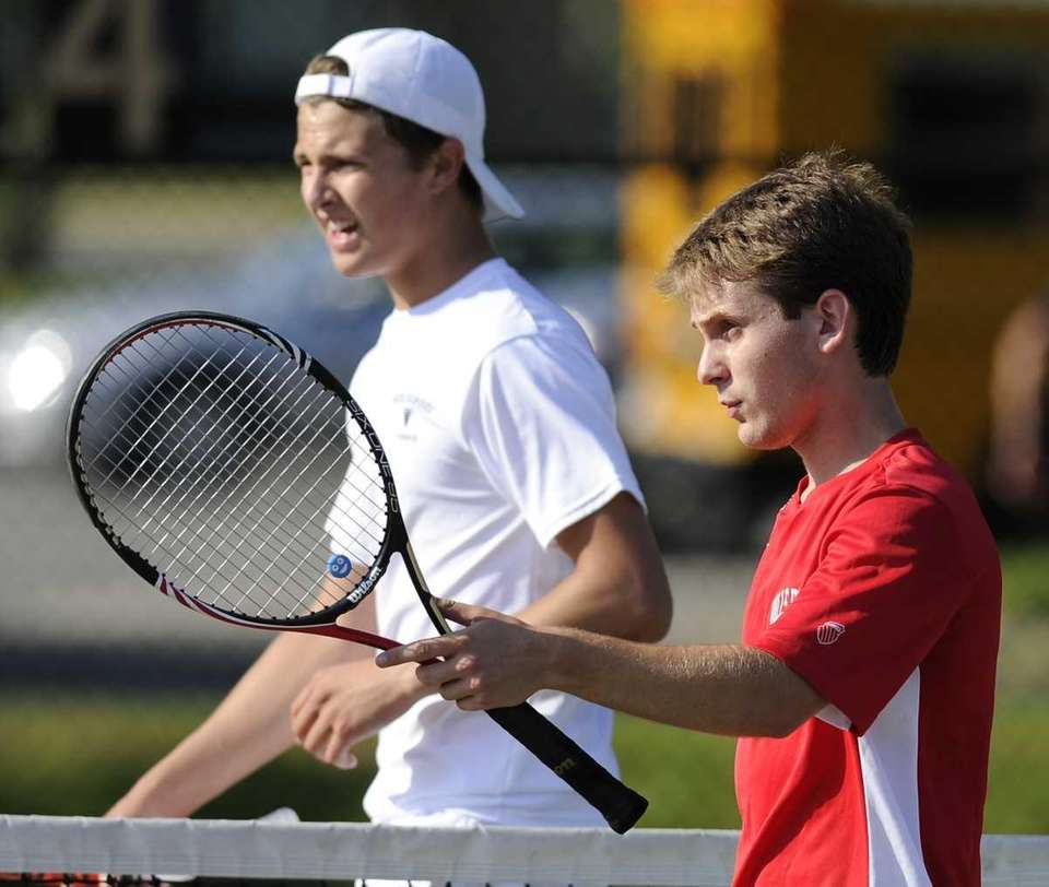 Half Hollow Hills East's Brett Teplitz, right, won
