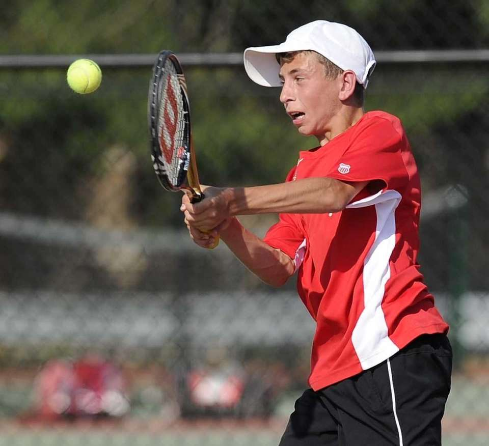 Half Hollow Hills East's Kyle Alper returns the