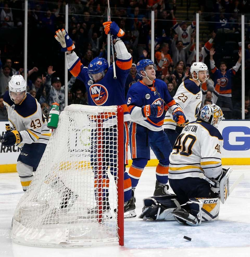 Ryan Pulock #6 of the Islanders celebrates his