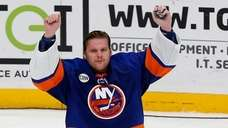 Robin Lehner of the Islanders celebrates after defeating