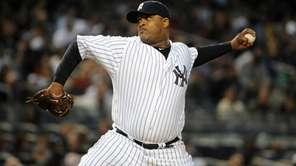 Yankees starting pitcher CC Sabathia throws in the