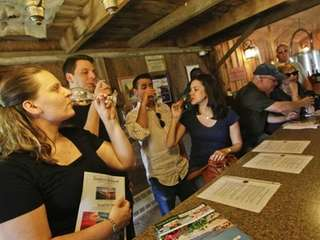 Visitors sample some of the nine wines available
