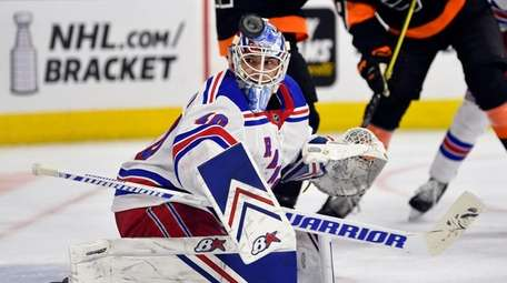 Rangers goaltender Alexandar Georgiev looks for the puck