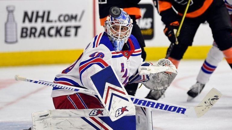 Rangers goaltender Alexandar Georgiev looks for the puck