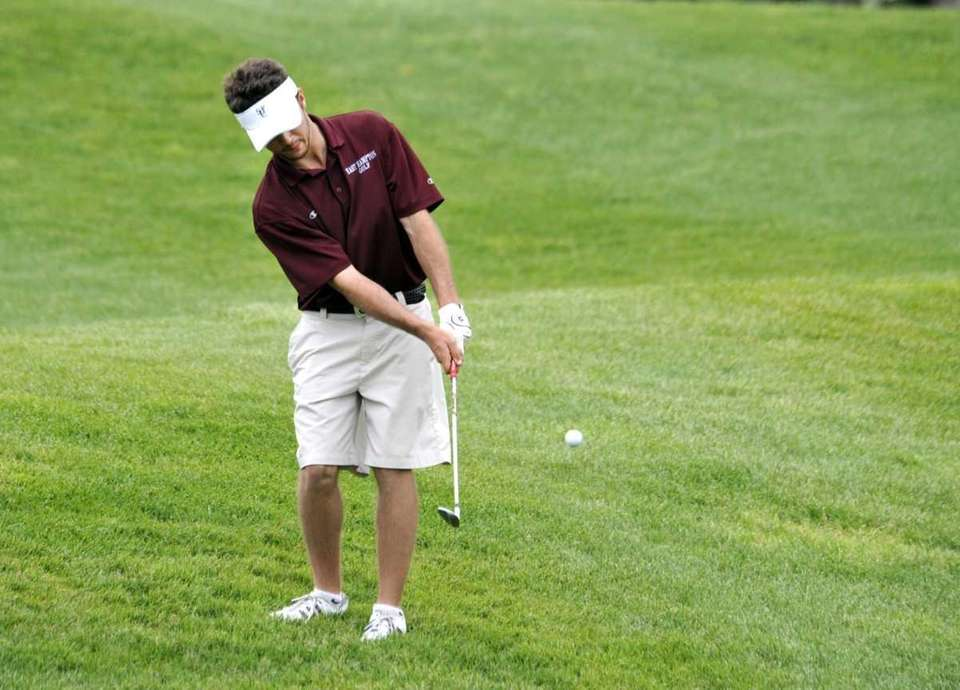 East Hampton's Zach Grossman chips onto the 18th