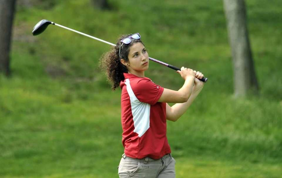Lauren Brenan of Smithtown East watches her tee