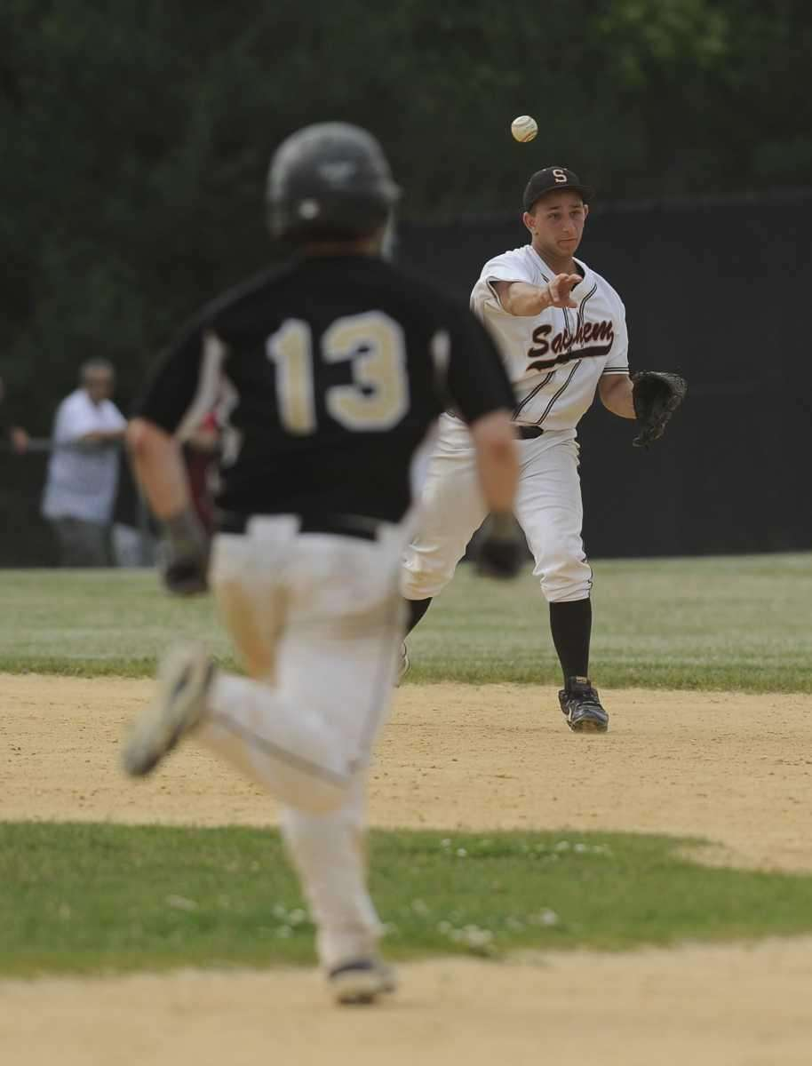Sachem North's Mike Vitale throws to second base