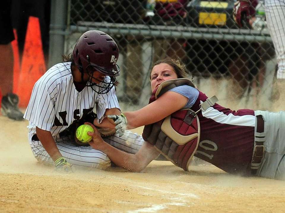 Bay Shore's Killeen Martin is tagged out at