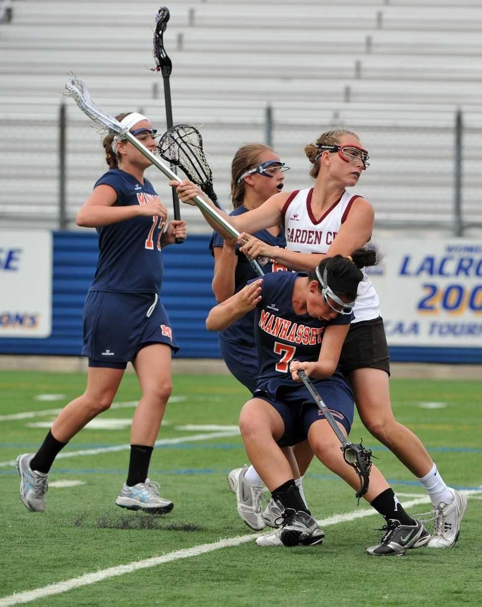 Manhasset senior Nicole Sockett (7) avoids being hit