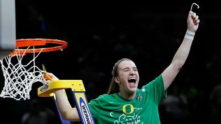 Oregon guard Sabrina Ionescu celebrates a regional final