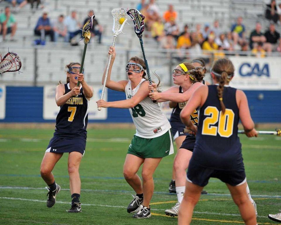 Farmingdale senior Krislyn Engelke (18) takes a shot