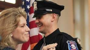 Officer Patrick McKeever receives his badge from Muttontown