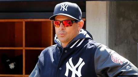 Manager Aaron Boone of the Yankees looks on