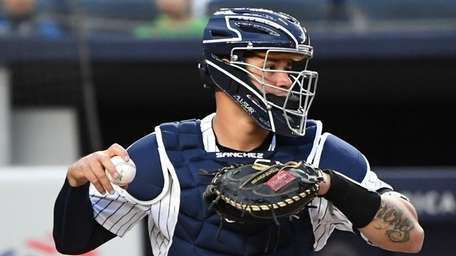 Yankees catcher Gary Sanchez looks before he throws