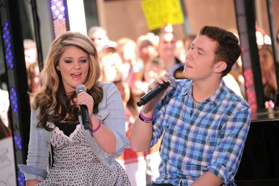 Singers Lauren Alaina and Scotty McCreery perform on