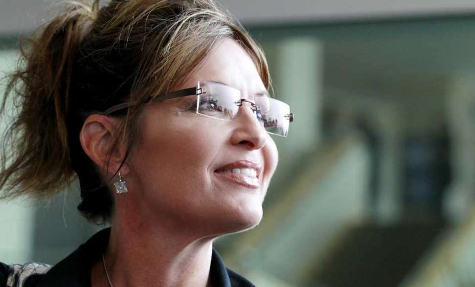 Former Alaska Gov. Sarah Palin exits the Hyatt