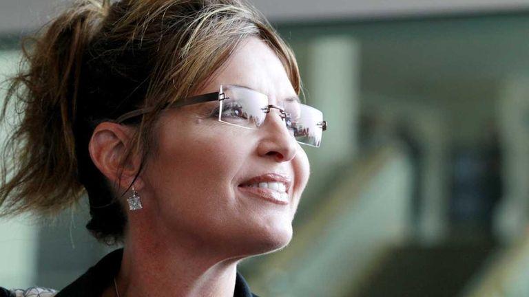 Former Alaska Gov. Sarah Palin exits the Hyatt