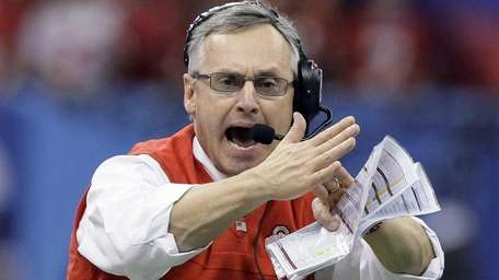 Ohio State coach Jim Tressel signals for a
