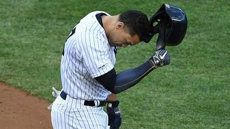 Giancarlo Stanton reacts after he strikes out to