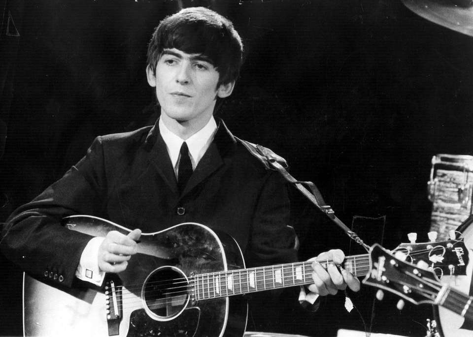 George Harrison was inducted twice: first with the