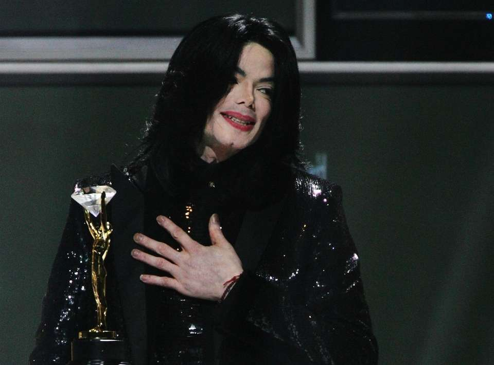 Michael Jackson was inducted twice: once with The