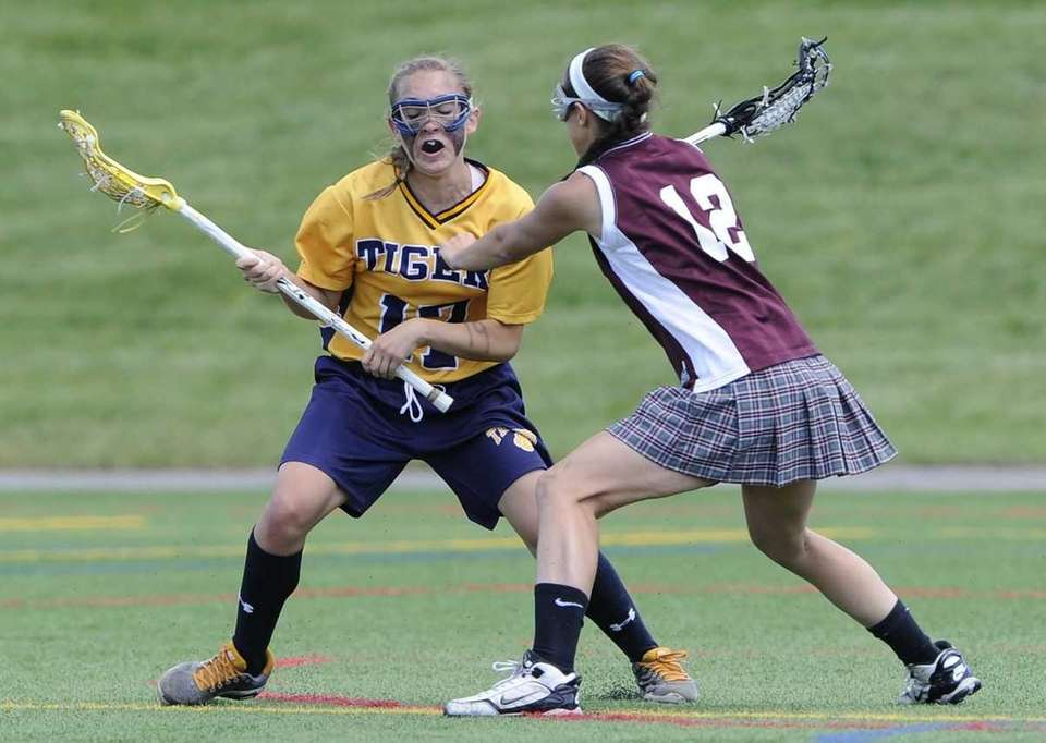 Northport's Erin Magnuson is defended by Bay Shore's