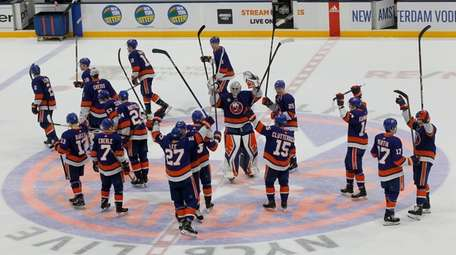 The Islanders celebrate after defeating the Buffalo Sabres