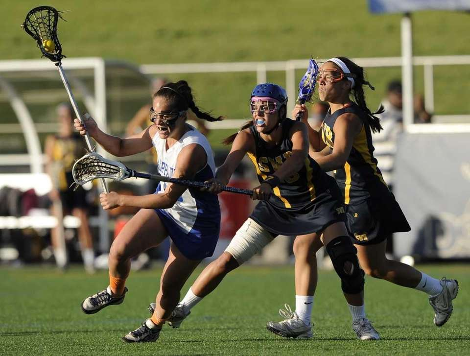 Hauppauge's Jessica Venturino is closely defended by Shoreham's