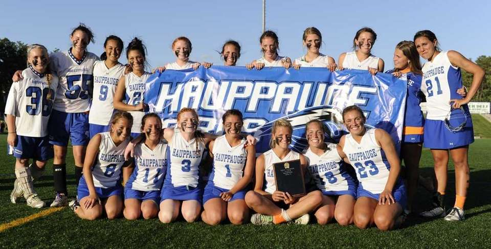 Hauppauge poses with their championship plaque from their