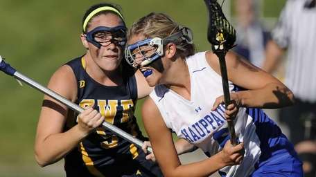 Hauppauge's Jennifer Porretto is defended by Shoreham-Wading River's